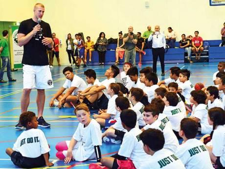 Mason Plumlee speaks to kids at camp